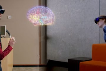Three students using HoloAnatomy with image of brain projected between them