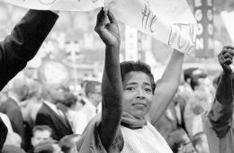Photo of man and woman holding banner during a Civil Rights protest