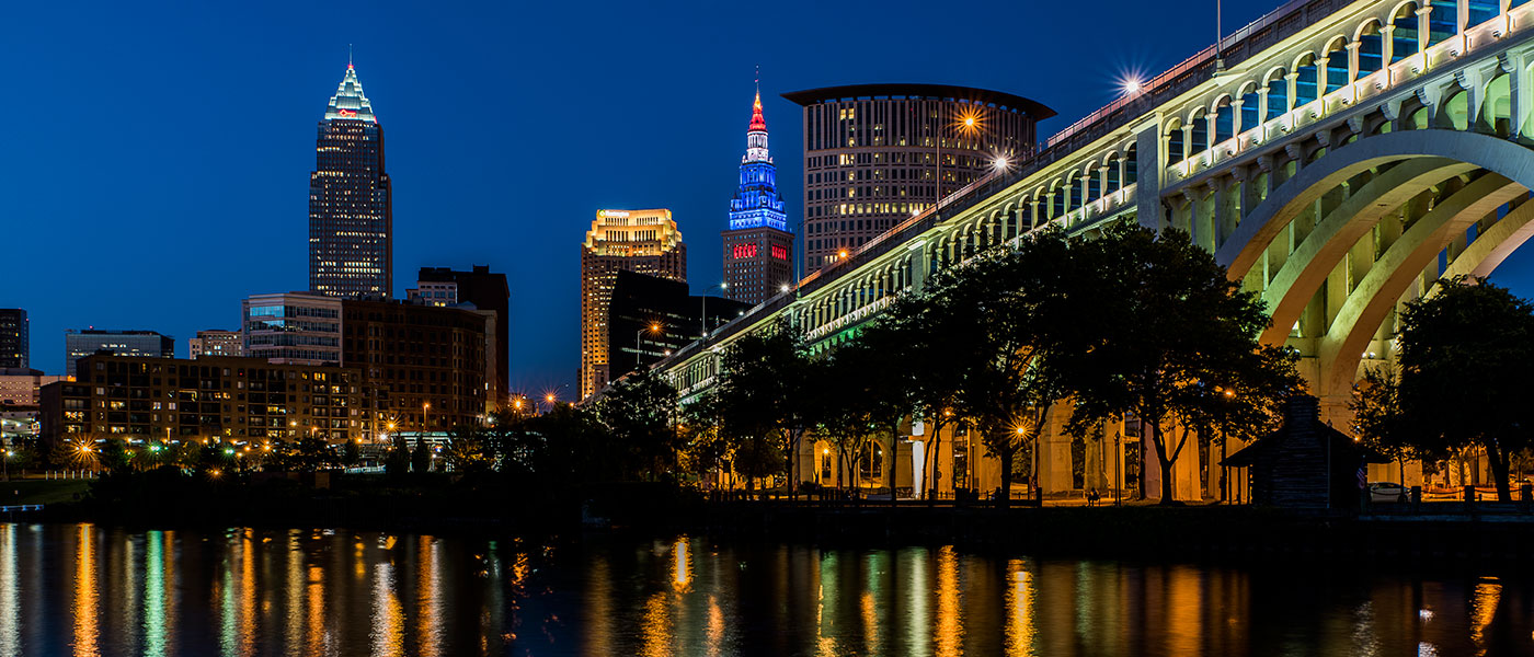 Cleveland skyline and bridge at dusk reflected on water