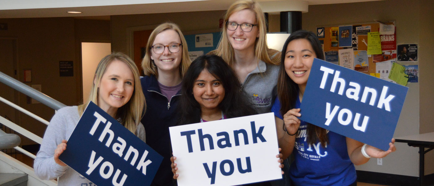 "Five female CWRU students hold signs that say ""thank you"""