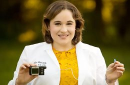Photo of Julia Blanchette holding insulin pump