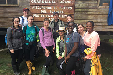 Mandel School students and Assistant Professor Mark Chupp pose for photo on study abroad trip to Ecuador