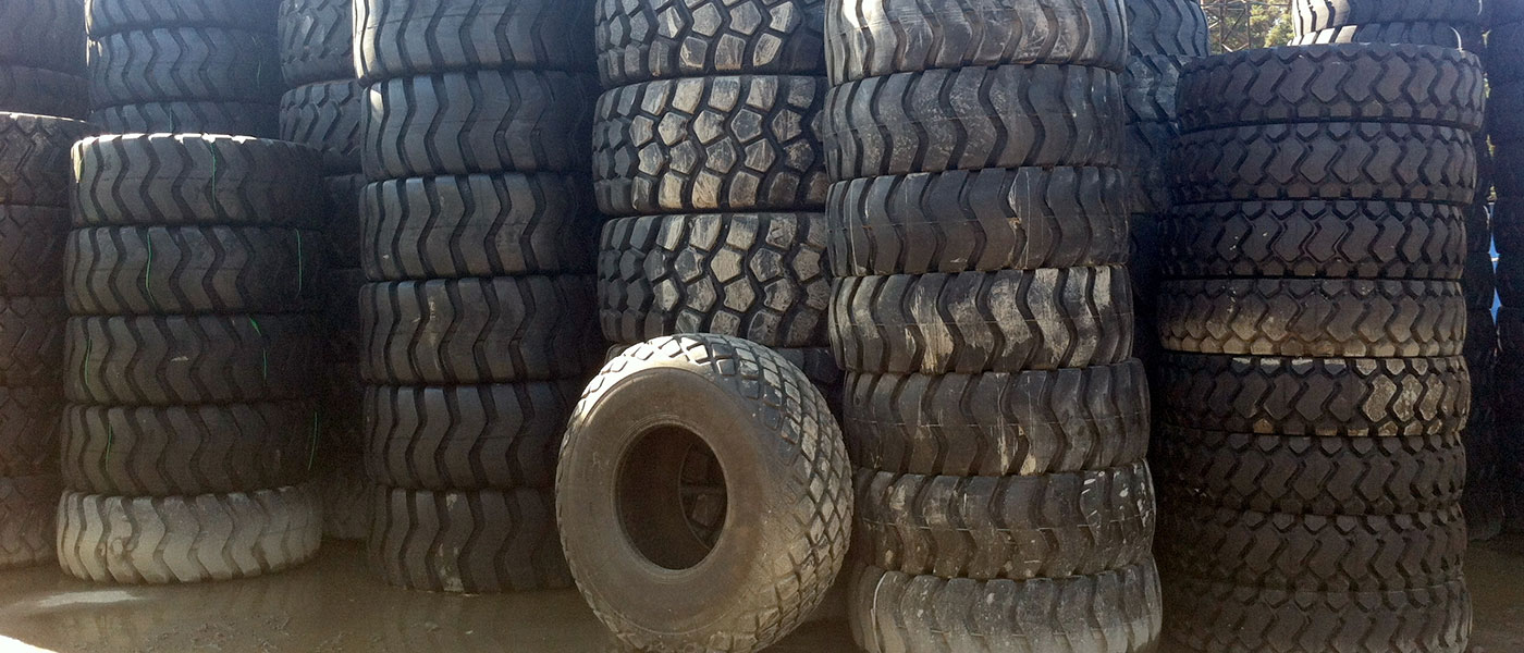 Photo of stacks of used tires.