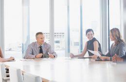 board members sitting at table in meeting
