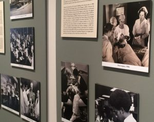 Historical photographs on museum wall.