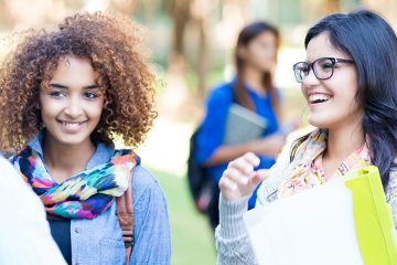 students talk on campus