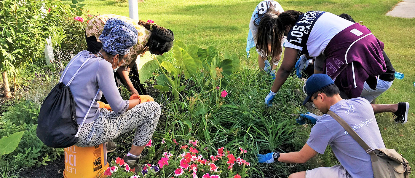 Students gardening during volunteer opportunity