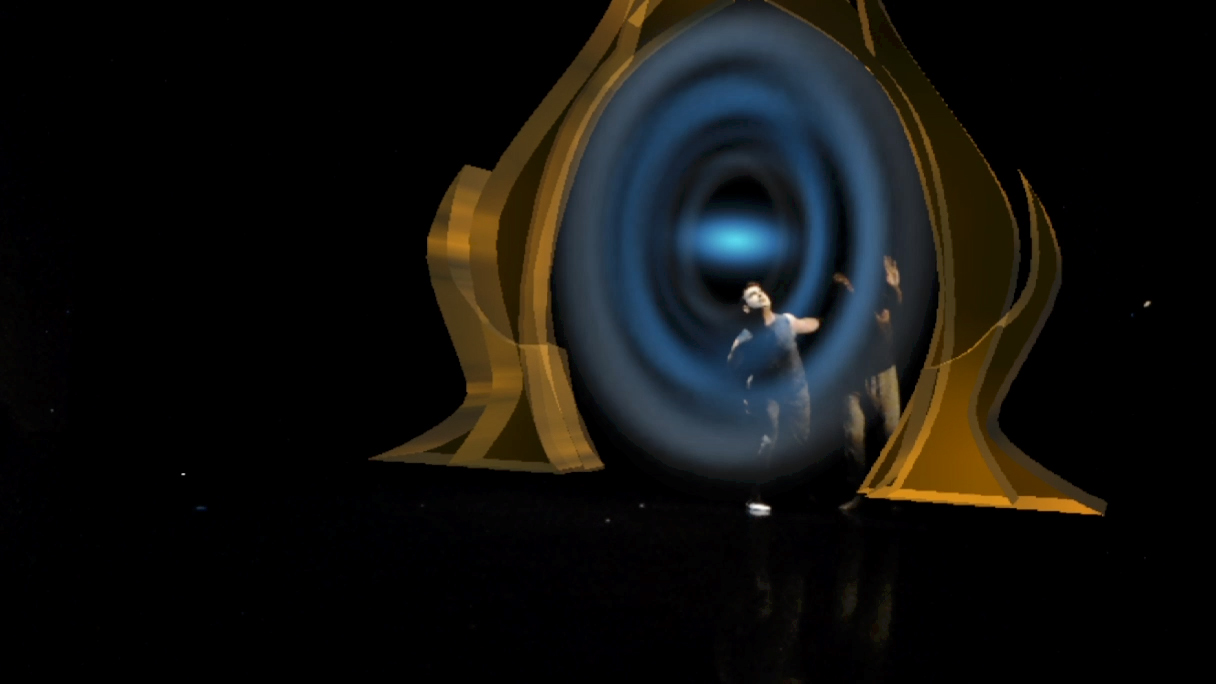 Still image from Imagined Odyssey with dancers near portal-like hologram