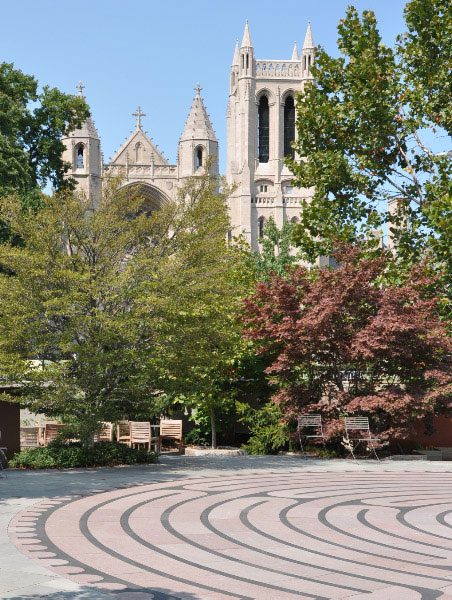 Photo of the McGaffin Tower with the labyrinth in the Schneider Healing Garden in the foreground