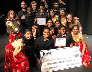 Dhamakapella team poses for photo with check from win at Jeena 2017