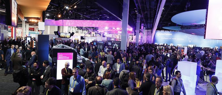 Wide view of CES 2017 showing people walking around the show floor