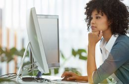 Photo of a young woman working at computer