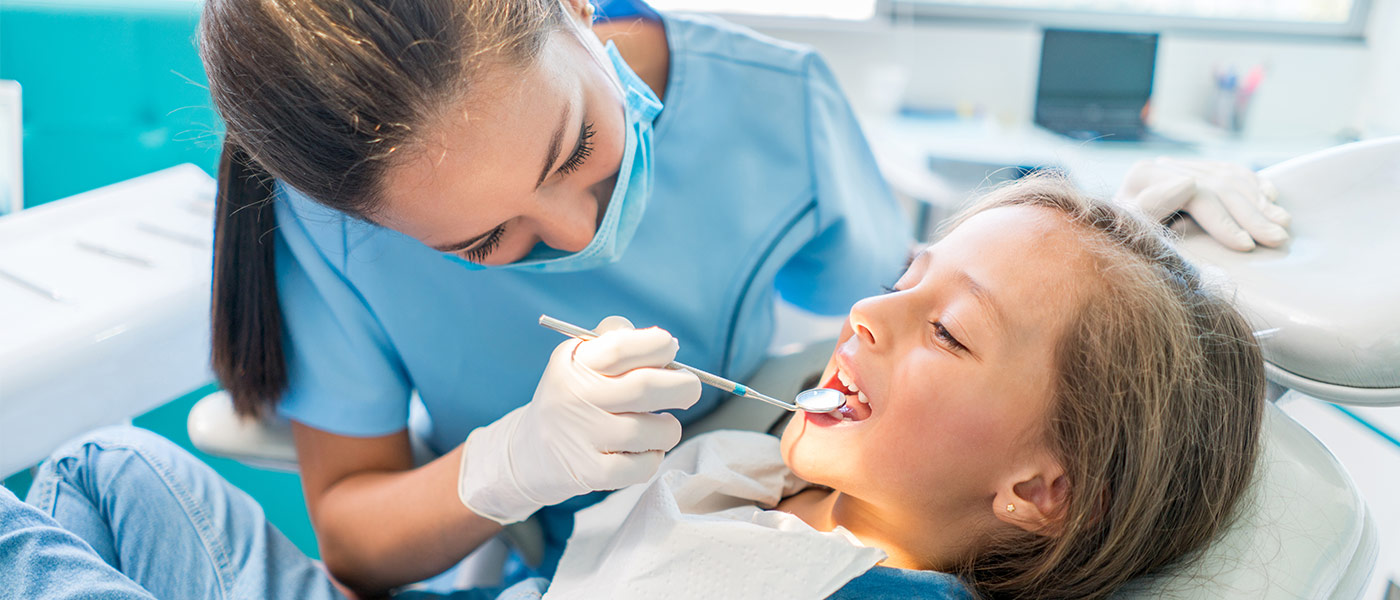 Dentist working on child's teeth