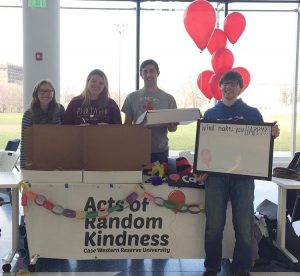 Students from the Acts of Random Kindness organization at a table in Tinkham Veale University Center