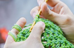 Close up on someone working on a crochet project