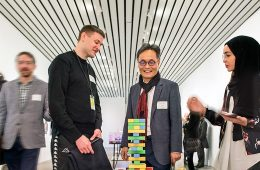 Artist Simon Denny, Professor Youngjin Yoo and student talk about and look at board game at MOCA