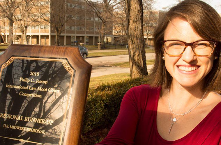 Photo of Allie Mooney holding plaque