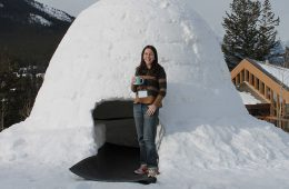 Photo of Elizabeth Meckes standing in front of igloo