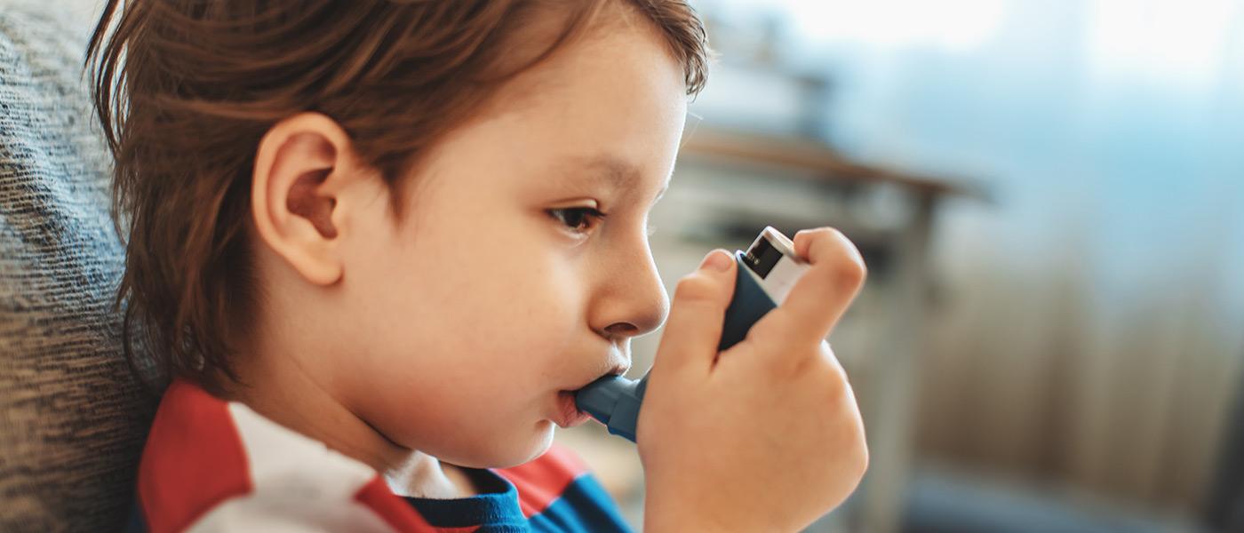 Little boy using inhaler