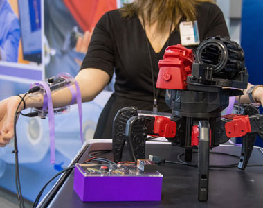 Photo of researcher with robot.