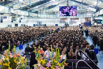 Photo from stage at 2017 commencement showing graduates