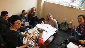 A group of Case Western Reserve students sitting around a table