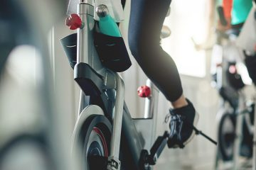 Photo of people working out on cycling machines