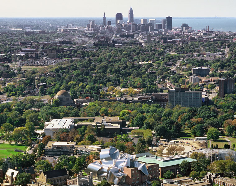 Aerial view of Case Western Reserve University in the foreground with Cleveland skyline in the background
