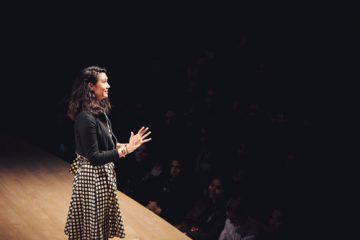 Sarah Kay speaking on stage
