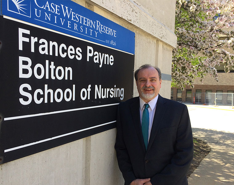 Christopher Burant photo outside nursing school