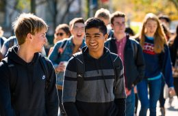 students walking on campus in large group