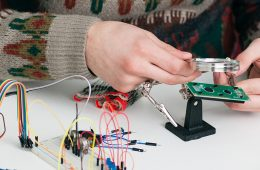 Engineering student tinkering with circuitry