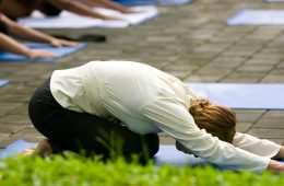 a woman leading yoga outside