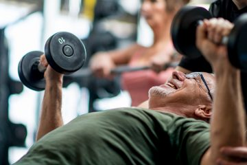 a man lifting weights at a fitness center