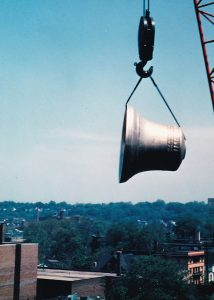 Largest bell of the McGaffin Carillon being hoisted over University Circle for installation in 1968