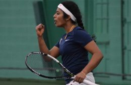 Nithya Kanagasegar celebrates on the tennis court