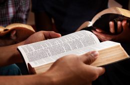 Young African-American adults gathered together at Bible study