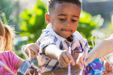 Photo of three kids doing crafts