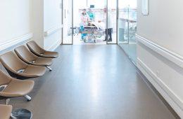Doctors wheel a patient into hospital hallway