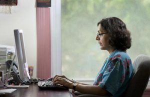 Thrity Umrigar typing on a computer