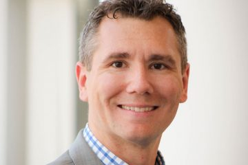 headshot of Case Western Reserve University marching band director Benjamin Helton