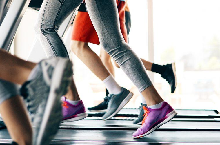 people's legs as they run on treadmills