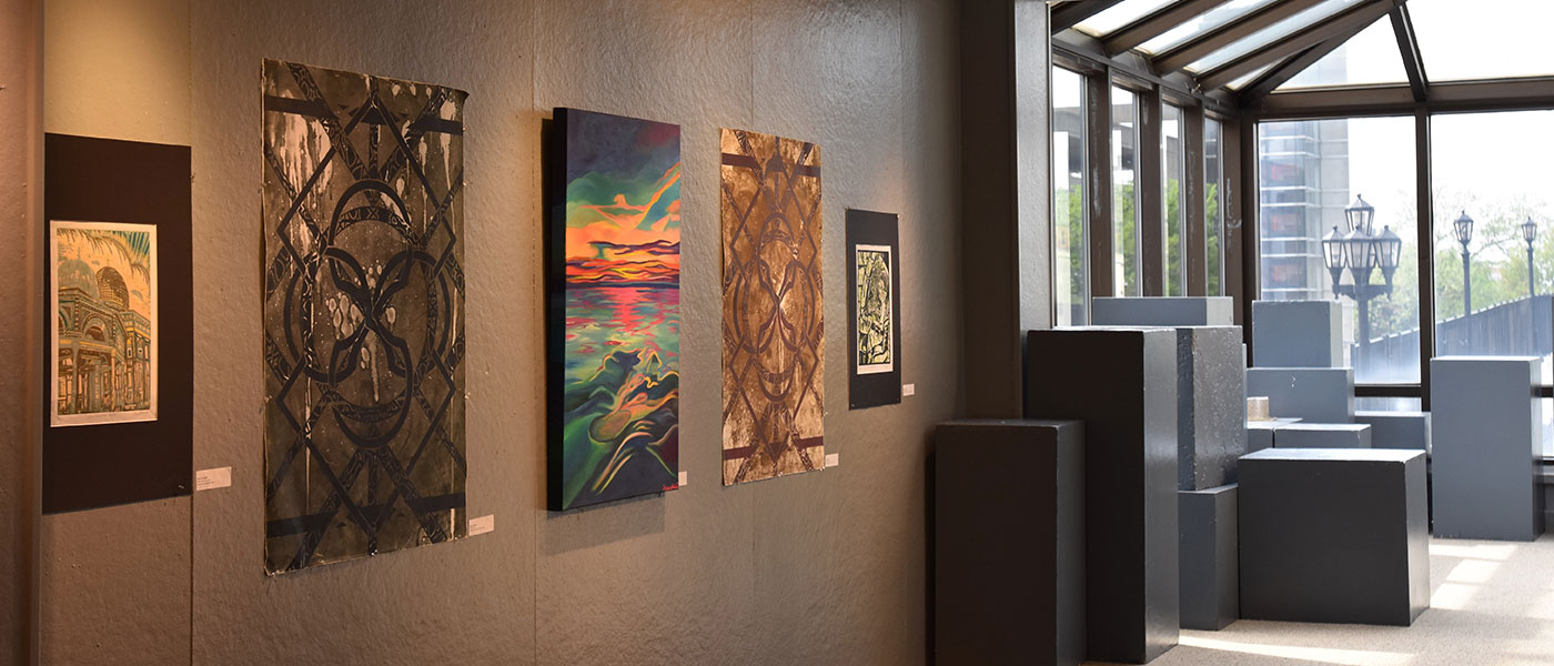 Artwork on the wall at the Case Western Reserve University Art Studio during a past exhibition