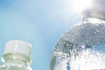 Photo of bottled water in sunlight.