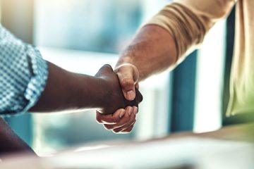 Close up photo of two people shaking hands
