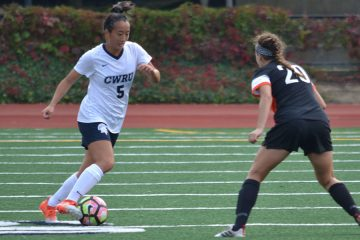 Case Western Reserve University soccer player Kimberly Chen tries to dribble past opposing player