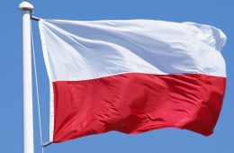 Photo of Poland's flag against a blue sky