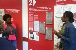 Woman talks to Mandel School students about the Undesign the Redline exhibit