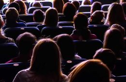 View from behind people sitting in a movie theater