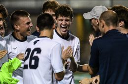 Members of the Case Western Reserve University men's soccer team gather in celebration